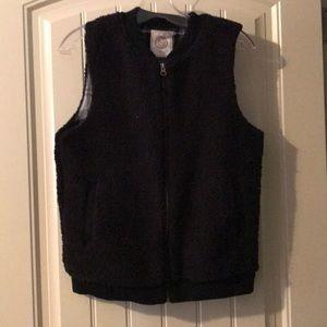 Sz L NWOT sharpa reversible vest.